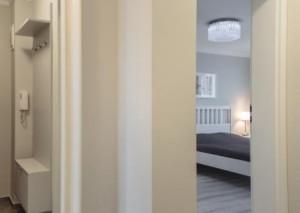 Horizontal view of open door to bedroom